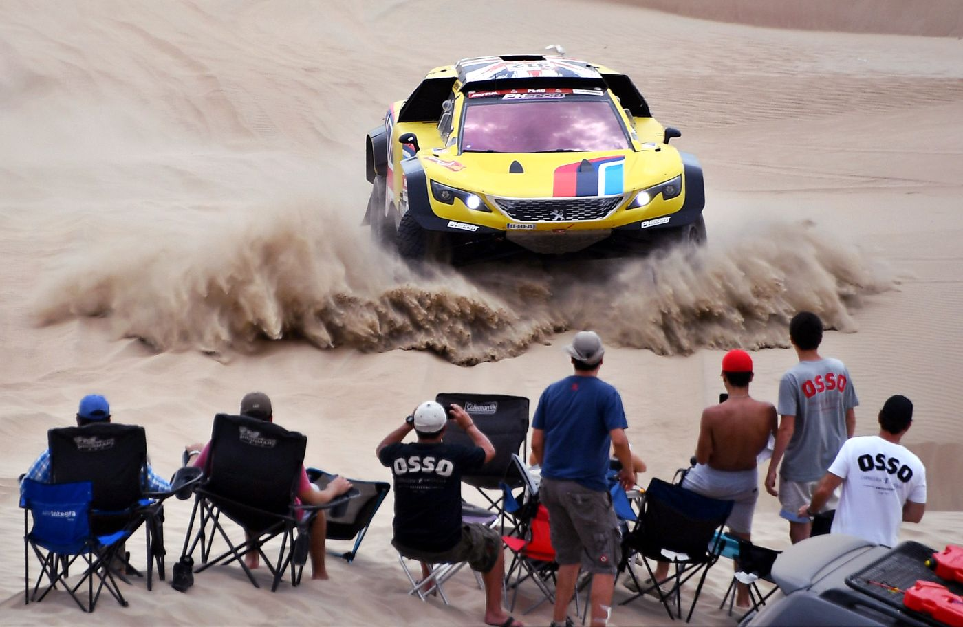 -- TOPSHOT - Peugeot's British driver Harry Hunt and Dutch co-driver Wouter Rosegarr compete during Stage 1 of the Dakar 2019 between Lima and Pisco, Peru, on January 7, 2019. Toyota's driver Nasser Al-Attiyah of Qatar and his co-driver Mathieu Baumel of France won the stage. / AFP / FRANCK FIFE