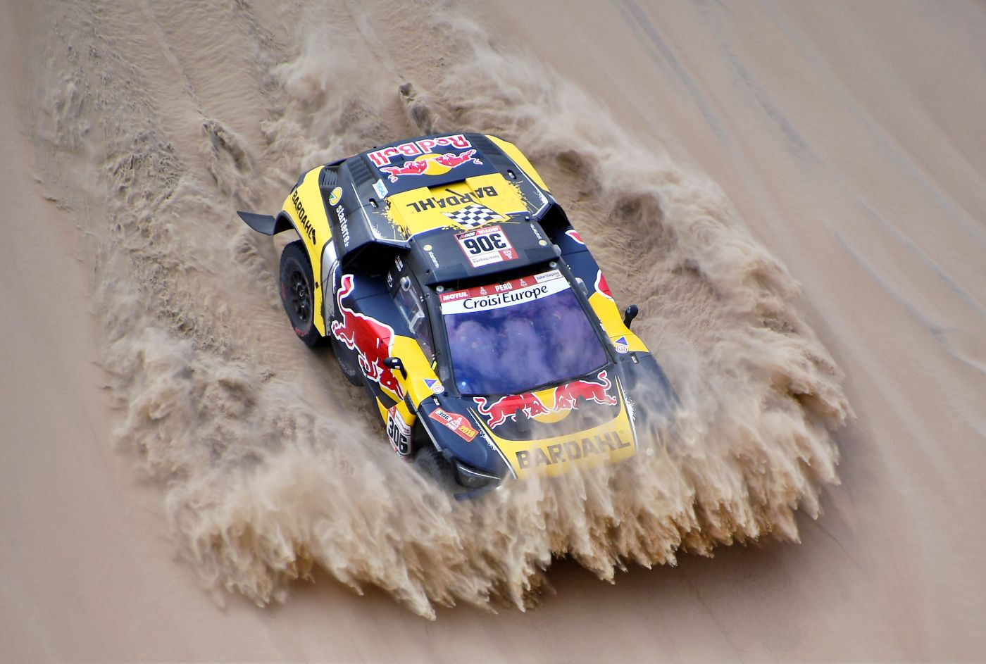 -- TOPSHOT - Peugeot's French driver Sebastien Loeb and co-driver Daniel Elena of Monaco compete during Stage 1 of the Dakar 2019 between Lima and Pisco, Peru, on January 7, 2019.  Toyota's driver Nasser Al-Attiyah of Qatar and his co-driver Mathieu Baumel of France  won the stage. / AFP / FRANCK FIFE